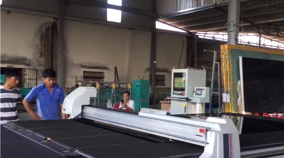 INTERMAC automatic system of loading + cutting + breaking glass at HOANG VINH GLASS